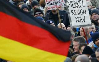 Thousands at far-right rally against Merkel migrant policy