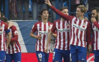 Torres reaches century, Atletico keep pressure on Barca