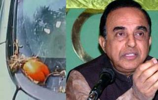 Congress workers attack Swamy's cavalcade with eggs, ink