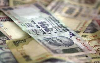 Rupee sinks 15 paise against US dollar in early trade
