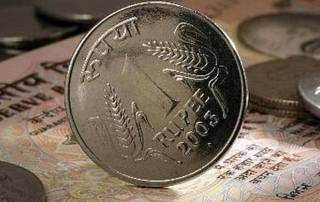 Rupee gains 20 paise against US dollar in early trade