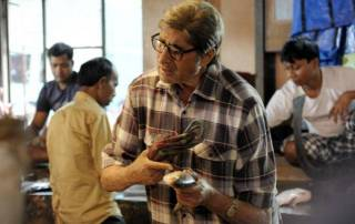 TE3N: After riding scooter, Amitabh Bachchan bargains at fish market