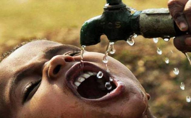 A child drinking water from a tap