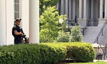 White House on lockdown after police report shooting nearby