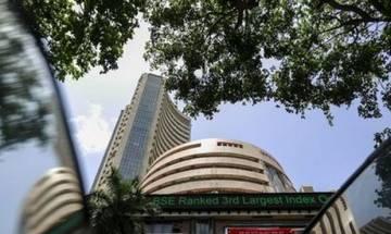 Raghuram Rajan keeps rates unchanged, Sensex stays in red