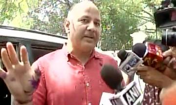 Watch video: Ink attack on Manish Sisodia outside LG's house, man who threw ink detained