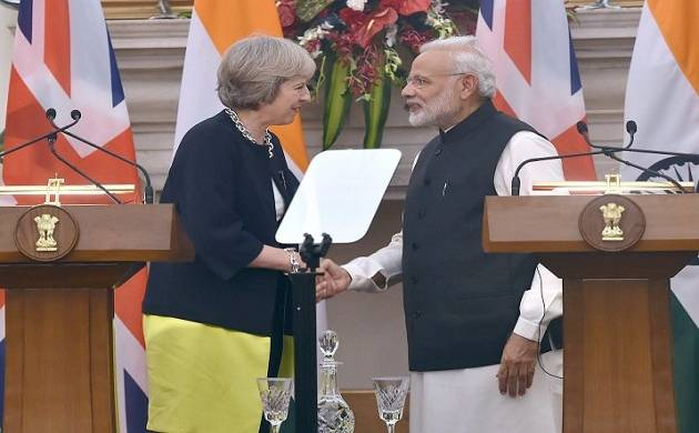 Indian PM Narendra Modi and United Kingdom's PM Theresa May - File Photo