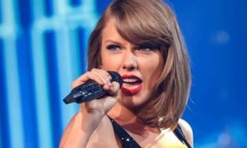 Singer Taylor Swift pays surprise visit to world war veteran
