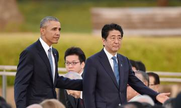 Obama-Abe talk about peace at historic Pearl Harbor visit