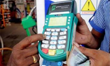 1% transaction fee on card payments at petrol pumps: Consumers will not have to pay any surcharge, says Oil Minister Pradhan