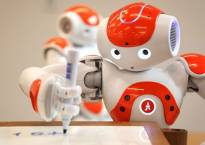 This robot is mightier than the sword: Xiao Nan pens down a writeup for Chinese daily