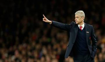 Arsene Wenger apologises after clash with fourth official