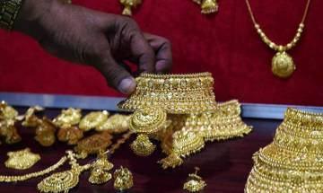 Gold gains sheen on domestic buying; silver regains Rs 42K
