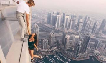 Watch: Russian Model risks life for near-death photoshoot, dangles off 1,000 ft skyscraper in Dubai