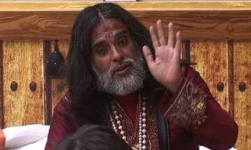 Video   Ex-Bigg Boss contestant Swami Om tries to join ABVP's march; students raise 'go back' slogan