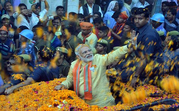 Prime Minister Narendra Modi waves towards supporters during a road show in Varanasi. (File: Getty Images)