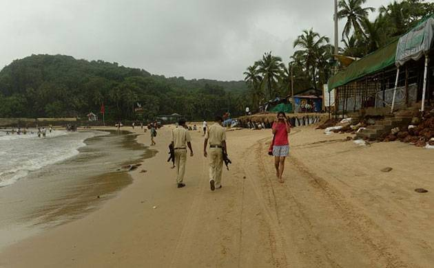 Policemen patrol as they watch over tourists visiting Baga beach in Goa. (File Photo: Getty)
