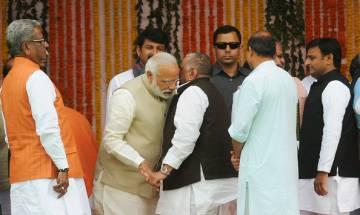 Yogi Adityanath's oath taking ceremony: Modi all ears to Mulayam, pats Akhilesh; Mayawati absent
