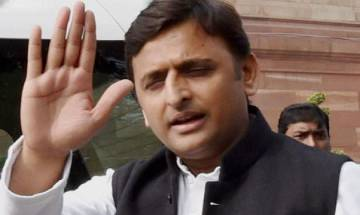 Would fetch fire brigade to spray 'Ganga Jal' on CM residence in 2022: Akhilesh