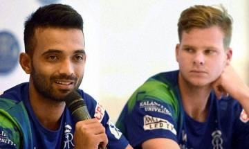 Australian captain Steve Smith offers beer to Ajinkya Rahane, Indian team