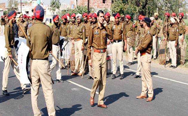 Police personnel stand guard at a site of a protest demonstration in Ludhiana. (File: Getty Images)