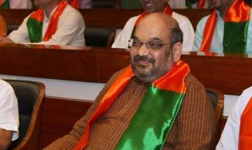BJP president Amit Shah gets enthusiastic welcome from partymen; offered two lotus garlands