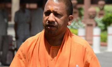 Inherited 1.21 lakh kms of potholed highways, will roll out new projects, says Yogi Adityanath