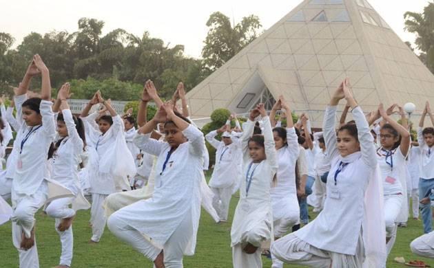 People doing Yoga - Representative image