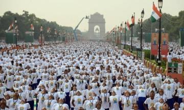 International Yoga Day: Delhiites fight rains to perform asanas