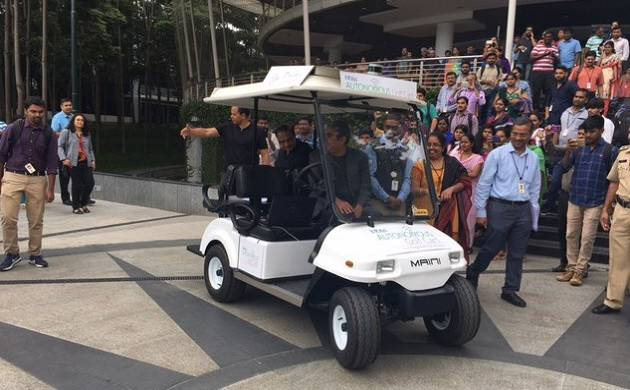 Infosys CEO Vishal Sikka makes stylish ever entry in 'driverless' cart (pic from Sikka's Twitter handle )