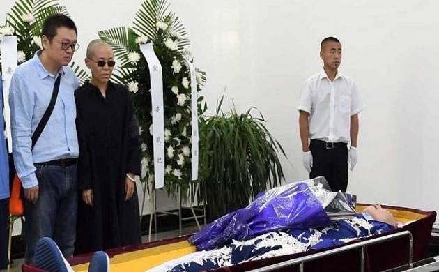 Nobel laureate Liu Xiaobo cremated; China says wife 'free so far'