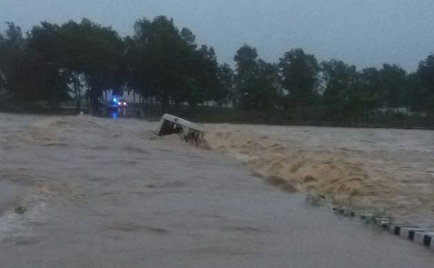 Ambulance along with four people washed away by floodwaters in Jharkhand.