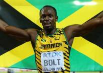 IAAF World Athletics Championships: Usain Bolt overcomes stuttering start to win 100 m heat, storms into semis