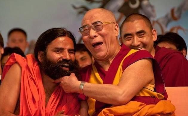 Dalai Lama tickles Ramdev on the stage of World Peace & Harmony