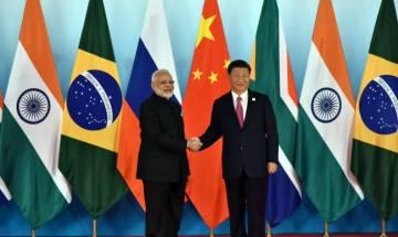 BRICS 2017: PM Modi, Chinese president Jinping display bonhomie on day 1
