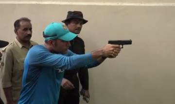 Watch   Dhoni's pistol shooting skills stumps Kolkata Police