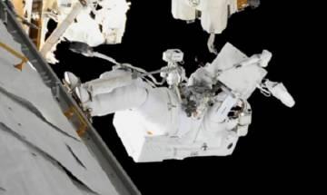 NASA astronauts grease robot arm's new hand