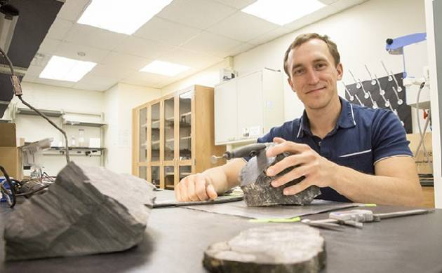 Geologist Erik Gulbranson studies fossilized trees discovered from Antarctica. (Source: University of Wisconsin--Milwaukee)