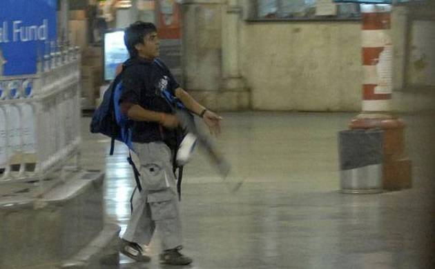 Ajmal Kasab walks out of the CST  (Photo-PTI file)