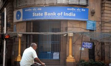 SBI lowers base rate, BPLR by 30 bps; leaves MCLR unchanged; RBI sets rupee reference rate at 63.6697 against USd