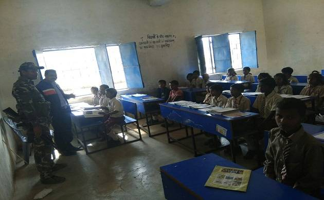 An inspector rank officer taking regular class of students in a remote village of Palamu.