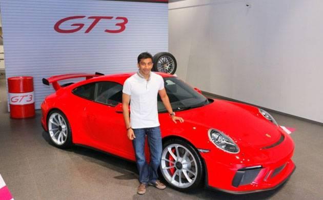 Narain Karthikeyan takes keys of his new Porsche 911 GT3 (Source: Twitter)