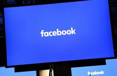 UK firm in Facebook row suspends CEO as lawmakers demand answers