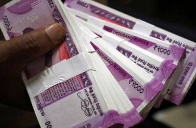 Rupee sheds 12 paise against US dollar