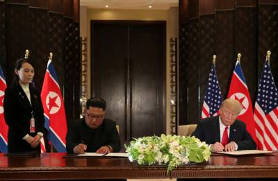 Donald Trump, Kim Jong-un sign 'comprehensive document' at historic Singapore summit