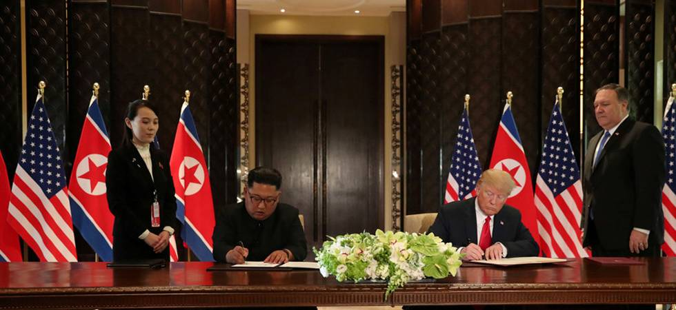 Donald Trump, Kim Jong-un signing the documents