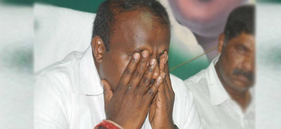 Tearful Karnataka CM HD Kumaraswamy addressing party workers in Bengaluru (PTI Photo)