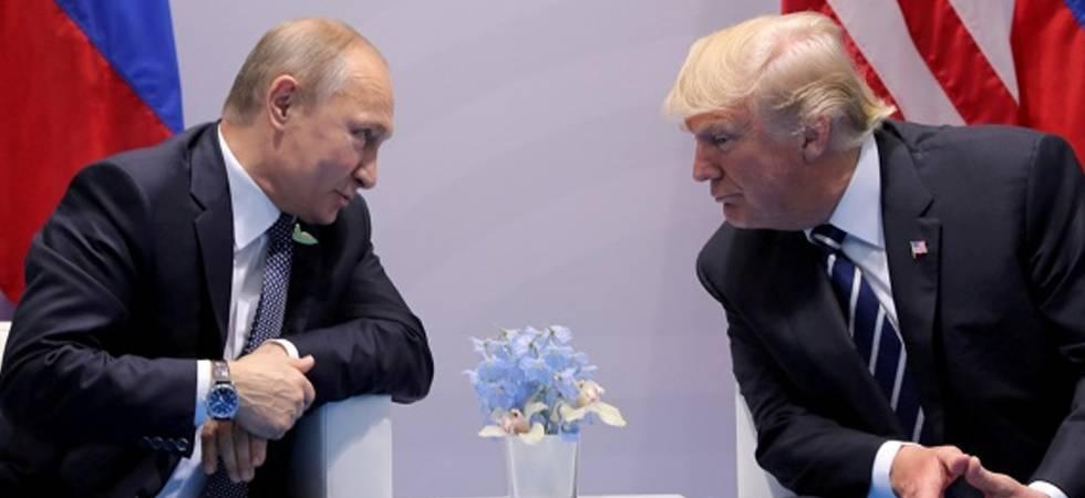 Russian President Vladimir Putin (L) with US President Trump (PHOTO: PTI)