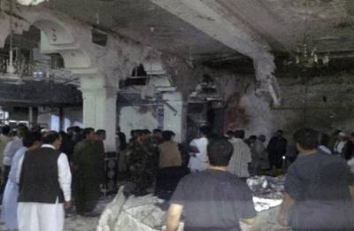 Twin suicide blasts kill at least 20 inside Afghan Shiite mosque