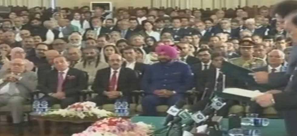 Navjot Singh Sidhu shares dais with President of PoK at Imran Khan's swearing-in (ANI Photo)